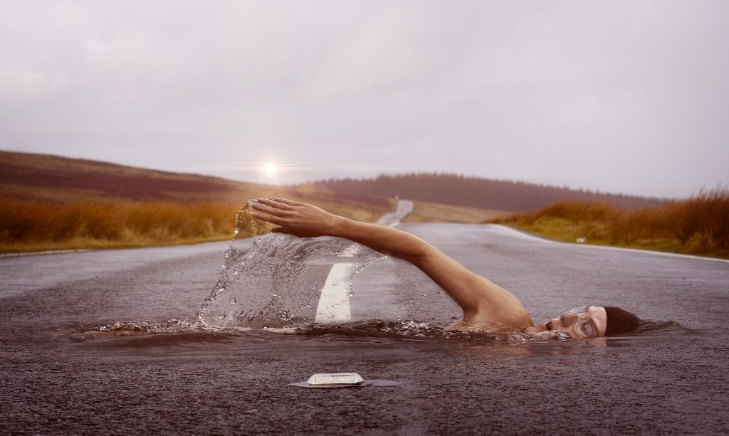 Swimmer in road