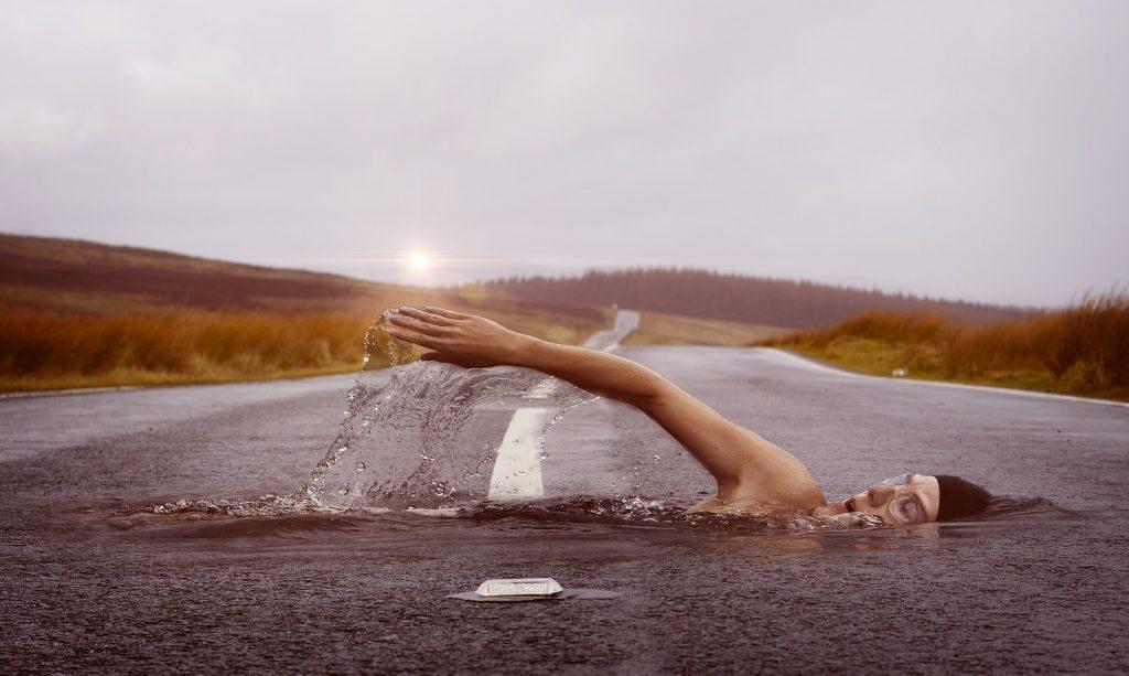 Swimmer in road